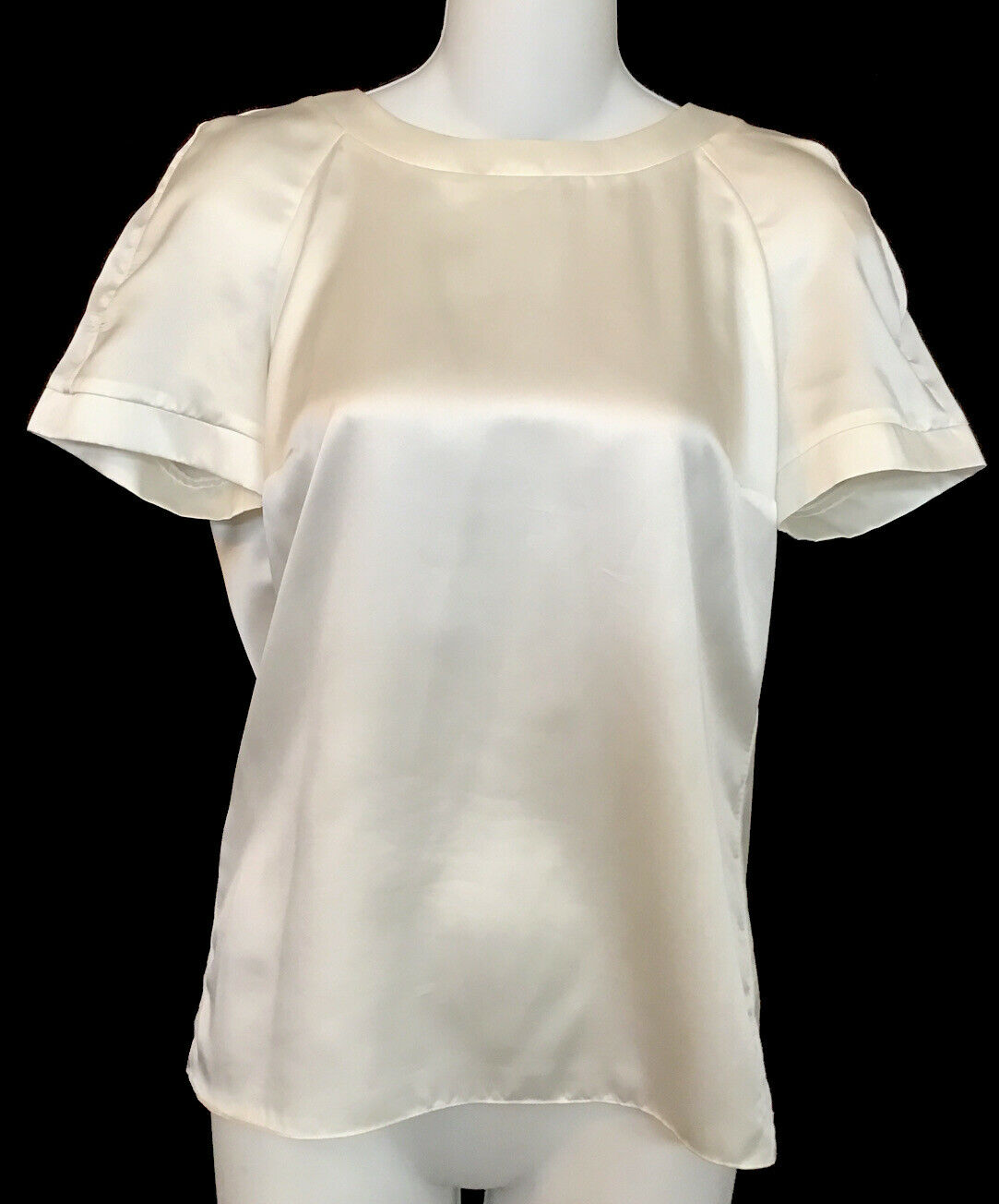 Chanel polyester blouse white short-sleeve preowned for sale on eBay, 2021 (Photo courtesy vegas_fashionista via eBay) Posted for media use