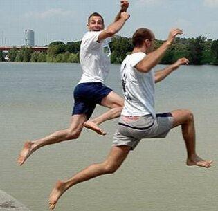 Men participate in The Big Jump 2021 by enjoying a river in the Jezera Eco-Center near Bijeljina, a city in Bosnia and Herzegovina.