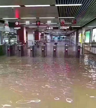 Heavy rain floods Chegongmiao Metro Station in the city of Shenzhen, China, June 13, 2017 (Photo by Chris) Creative Commons license via Flickr