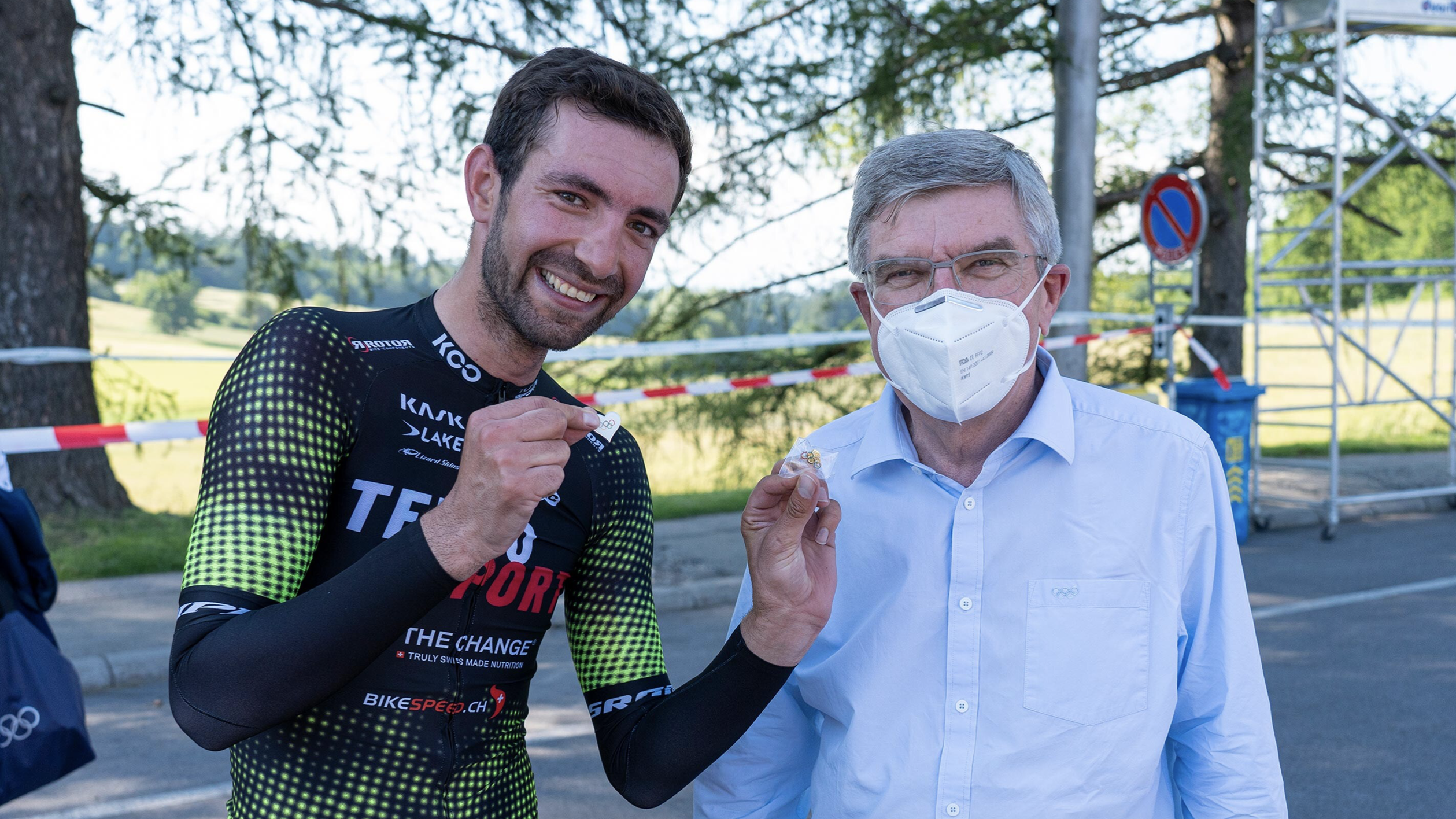 Thomas Bach, president of the International Olympic Committee (IOC), right, was at the Swiss National Cycling Time Trials to support Ahmad Badreddin Wais, one of the newly selected athletes on the IOC Refugee Olympic Team Tokyo 2020. June 16, 2021, Lausanne, Switzerland (Photo courtesy IOC) Posted for media use