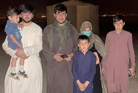 Former Afghan national police officer Mohammad Khalid Wardak and his family wait in an undisclosed location for a flight out of Kabul, Afghanistan. August 18, 2021 (Photo credit unknown, provided to the Voice of America)