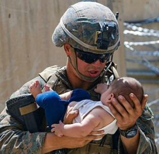 A U.S. Marine comforts an infant while they wait for the child's mother during an evacuation at the Hamid Karzai International Airport in Kabul, Afghanistan. August 22, 2021 (Photo by U.S. Marine Lance Cpl. Nicholas Guevara) Public domain