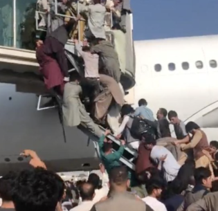 Thousands of Afghans, desperate to escape Taliban control, crowd a departing plane at Hamid Karzai International Airport in Kabul, Afghanistan, August 16, 2021 (Photo by Budiey) Creative Commons license via Flickr