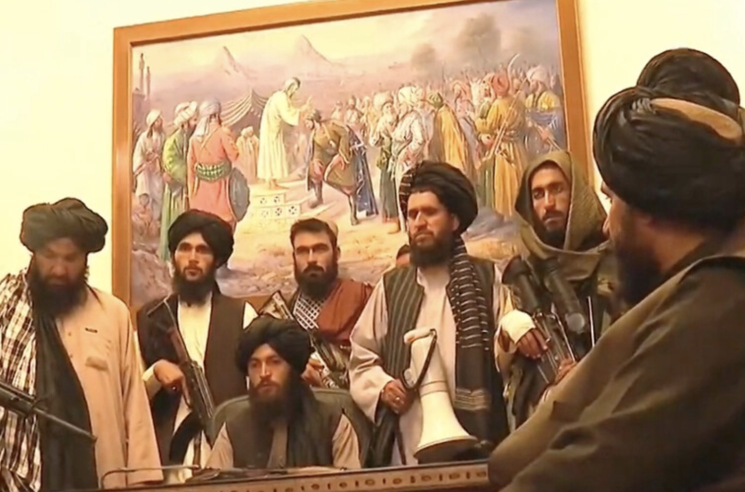 A group of Taliban fighters in a government office in Kabul, Afghanistan, the day they took control of the country, August 15, 2021. (Photo by Daniel Moskowitz) Public domain