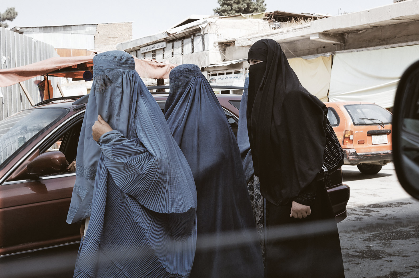 Afghan women wearing burkas on a street in the capital Kabul, January 19, 2014 (Photo by lynnstarbucks) Creative Commons license via Flickr